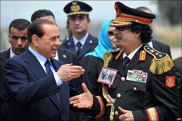 Gaddafi and Berlusconi handshake
